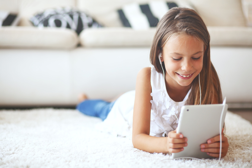 Pre teen girl with tablet pc